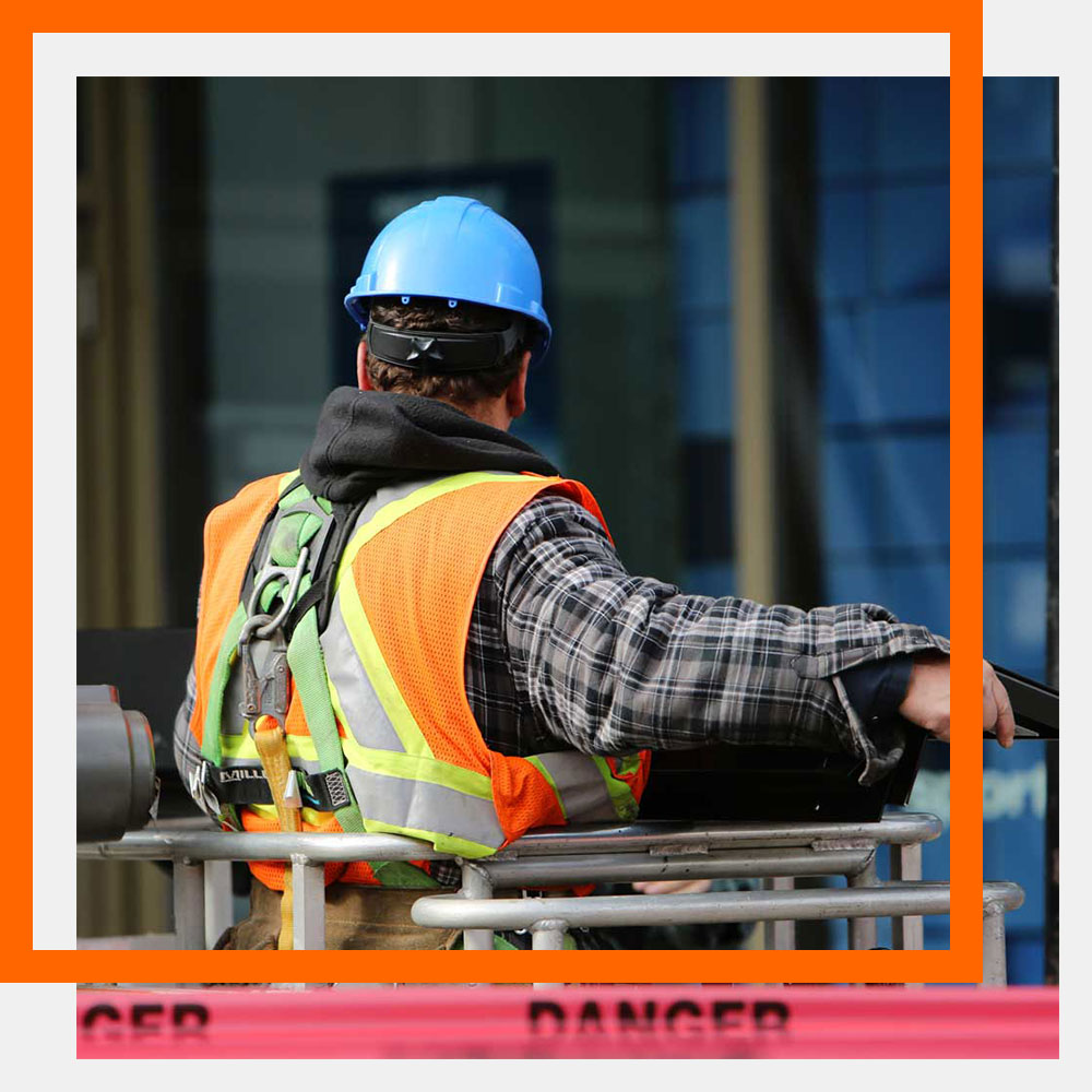 Alberta Mechanical Contractor in Orange safety vest
